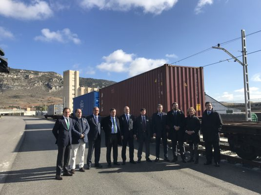 Delegates of the Port of Bilbao and other authorities beside the train